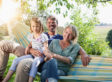 Happy family sitting in hammock